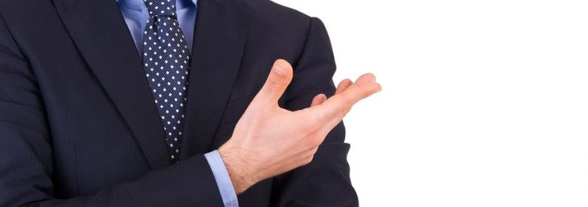 18929253 - businessman gesturing with hand